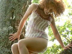 Curly Hair Girl In A Tree Masturbating Her Sexy Slit